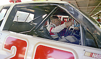 Race car driver Bobby Allison straps into his race car at  Atlanta International Raceway, Atlanta Journal 500, November 1983.  (Photo by Brian Cleary/www.bcpix.com)