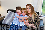 Saidhbhe Ní Fhlatharta and big brother Luke with her son George who was rescued from drowning on Ventry beach