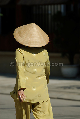 Asia, Vietnam, Hue. Tradionally dressed vietnamese woman in Hue.