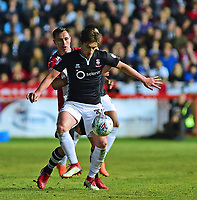 Lincoln City's Alex Woodyard shields the ball from Exeter City's Jordan Tillson<br /> <br /> Photographer Andrew Vaughan/CameraSport<br /> <br /> The EFL Sky Bet League Two Play Off Second Leg - Exeter City v Lincoln City - Thursday 17th May 2018 - St James Park - Exeter<br /> <br /> World Copyright &copy; 2018 CameraSport. All rights reserved. 43 Linden Ave. Countesthorpe. Leicester. England. LE8 5PG - Tel: +44 (0) 116 277 4147 - admin@camerasport.com - www.camerasport.com