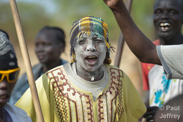 In preparation for a wedding, Dinka villagers dance on April 14, 2017, in Poktap, a town in South Sudan's Jonglei State where conflict, drought and inflation have caused severe food insecurity.<br /> <br /> The white on the man's face is a mixture of ash and cow dung that Dinka cattle keepers traditionally apply to ward off flies.<br /> <br /> The Lutheran World Federation, a member of the ACT Alliance, is helping families in the area tackle food problems, as well as providing support for housing and education.