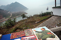 CHINA. Chongqing Province.  A poster of Mao near the town of Fengdu that is yo be flooded by damming the Yangtze near the town of YiChang. It  has remained a controversial subject due to the negative environmental consequences and the displacement of millions of people in the flood plain. The Yangtze River however is reported to be at its lowest level in 150 years as a result of a country-wide drought. It is China's longest river and the third longest in the world. Originating in Tibet, the river flows for 3,964 miles (6,380km) through central China into the East China Sea at Shanghai.  2008.