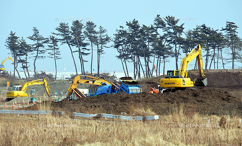 March 7, 2013, Sendai, Japan - Construction of levees continues along Yuriage Hama, the scenic beach facing the Pacific Ocean near Sendai, Miyagi Prefecture, on March 7, 2013. Two years ago on March 11, mounds of tsunami swallowed up what's been left by the Magnitude 9.0 earthquake which struck the nation's northeast region, leaving more than 15,000 people dead and ravaging wide swaths of coastal towns and villages.  (Photo by Natsuki Sakai/AFLO)