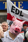 © Joel Goodman - 07973 332324 . 04/05/2013 . Leeds , UK . An EDL supporter with a mock pig's head at the demonstration . The English Defence League hold a demonstration in the Moortown housing estate in Leeds over plans to convert a disused pub in to an Islamic Centre . This is the first EDL demonstration in the region since six men were convicted of planning a terrorist attack on an EDL demonstration in Dewsbury . Photo credit : Joel Goodman