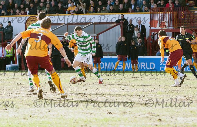 Gary Hooper trying to find a way through the Motherwell defence
