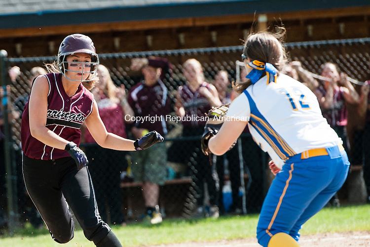 SEYMOUR, CT-30 May 2014-053014EC09-  Torrington's Nicole Jamieson tries to avoid getting the tag by Seymour's Makayla O'Hara. Jamieson was called out. The Wildcats defeated the Red Raiders, 2-1, to win the NVL softball championship at Woodland Friday. Erin Covey Republican-American