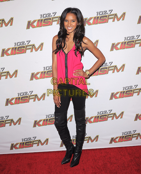 ELIZABETH MATHIS.Pressroom at the KIIS FM Wango Tango 2011 held at The Staples Center in Los Angeles, California, USA. .May 14th, 2011.full length hand on hip pink sleeveless top black leggings boots thigh high knee otk.CAP/RKE/DVS.©DVS/RockinExposures/Capital Pictures.