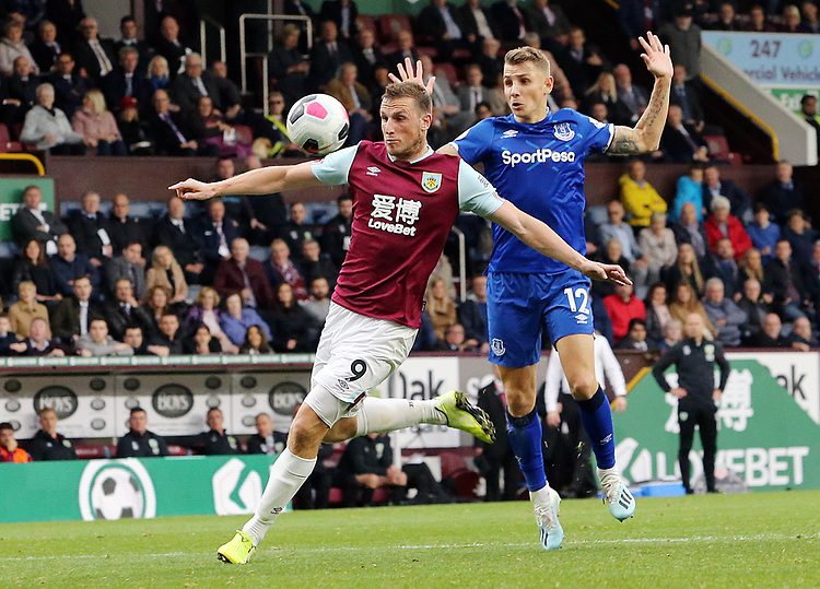 Burnley's Chris Wood vies for possession with Everton's Lucas Digne<br /> <br /> Photographer Rich Linley/CameraSport<br /> <br /> The Premier League - Burnley v Everton - Saturday 5th October 2019 - Turf Moor - Burnley<br /> <br /> World Copyright © 2019 CameraSport. All rights reserved. 43 Linden Ave. Countesthorpe. Leicester. England. LE8 5PG - Tel: +44 (0) 116 277 4147 - admin@camerasport.com - www.camerasport.com