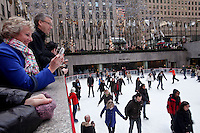 An french visitor takes a picture at the Rockefeller Center in New York, United States. 5/01/2012. Officials announced the arrival of the record-breaking 50 millionth visitor of the year. Photo by Kena Betancur / VIEWpress.