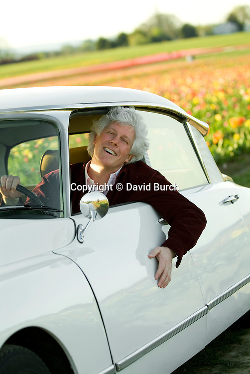 Man in car, smiling, portrait