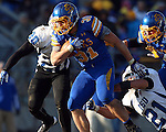 BROOKINGS, SD - NOVEMBER 9:  Zach Zenner #31 from South Dakota State University is brought down by Jameer Thurman #20 and Mark Sewall #21 from Indiana State University Saturday at Coughlin Alumni Stadium. (Photo by Dave Eggen/Inertia)