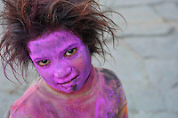 Girl covered in color during the Holi Festival Jaipur, Rajasthan India