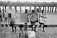 06 Dec 1969, Atlantic City, New Jersey, USA --- Women's Liberation Movement demonstrators carrying picket signs in protest against the Miss America pageant in Atlantic City, New Jersey. --- Image by © JP Laffont