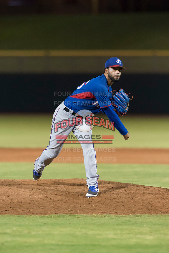 AZL Rangers relief pitcher Luis Rosario (76) follows through on his delivery during an Arizona League game against the AZL Giants Black at Scottsdale Stadium on August 4, 2018 in Scottsdale, Arizona. The AZL Giants Black defeated the AZL Rangers by a score of 6-3 in the second game of a doubleheader. (Zachary Lucy/Four Seam Images)