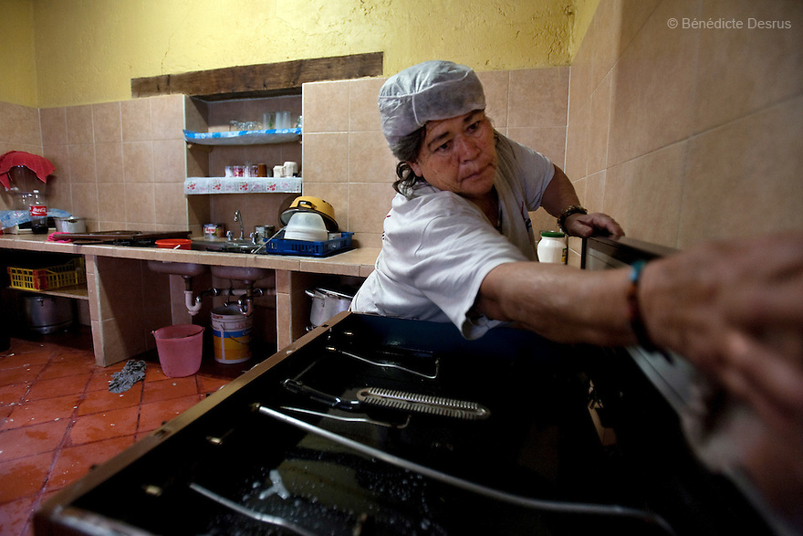 Amalia, a resident of Casa Xochiquetzal, cleans the kitchen at the shelter in Mexico City, Mexico on August 3, 2009. Casa Xochiquetzal is a shelter for elderly sex workers in Mexico City. It gives the women refuge, food, health services, a space to learn about their human rights and courses to help them rediscover their self-confidence and deal with traumatic aspects of their lives. Casa Xochiquetzal provides a space to age with dignity for a group of vulnerable women who are often invisible to society at large. It is the only such shelter existing in Latin America. Photo by Bénédicte Desrus