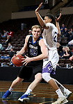 SIOUX FALLS, SD - MARCH 12:  Bryce Lienhoop #23 from St. Francis backs down Aziz Leeks #22 from the College of Idaho during their semifinal game at the 2018 NAIA DII Men's Basketball Championship at the Sanford Pentagon in Sioux Falls. (Photo by Dave Eggen/Inertia)