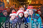 Pictured at the Santa parade in Killarney on Friday from left Bailey O'Sullivan, Sam Casey, Ben Cassen and Peter O'Sullivan.