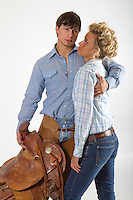 Western cowgirl cowboy riding romance novel cover photograph by Jenn LeBlanc and Studio Smexy