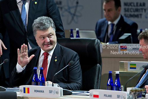 """Petro Poroshenko, Ukraine's president, waves during an opening plenary entitled """"National Actions to Enhance Nuclear Security"""" at the Nuclear Security Summit in Washington, D.C., U.S., on Friday, April 1, 2016. After a spate of terrorist attacks from Europe to Africa, U.S. President Barack Obama is rallying international support during the summit for an effort to keep Islamic State and similar groups from obtaining nuclear material and other weapons of mass destruction. <br /> Credit: Andrew Harrer / Pool via CNP"""
