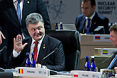 "Petro Poroshenko, Ukraine's president, waves during an opening plenary entitled ""National Actions to Enhance Nuclear Security"" at the Nuclear Security Summit in Washington, D.C., U.S., on Friday, April 1, 2016. After a spate of terrorist attacks from Europe to Africa, U.S. President Barack Obama is rallying international support during the summit for an effort to keep Islamic State and similar groups from obtaining nuclear material and other weapons of mass destruction. <br /> Credit: Andrew Harrer / Pool via CNP"