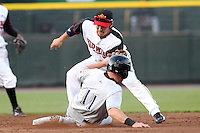 Rochester Red Wings second baseman Tsuyoshi Nishioka #1 tags out Bill Rhinehart #11 sliding in during a game against the Louisville Bats at Frontier Field on May 15, 2012 in Rochester, New York.  Rochester defeated Louisville 5-4.  (Mike Janes/Four Seam Images)