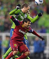 Seattle Sounders FC defender Zach Scott and Real Salt Lake midfielder Javier Morales battle for the ball during play in a Major League Soccer Wester Conference Semifinal match at CenturyLink Field in Seattle Wednesday November 2, 2011. The Sounders won the match 2-0, but lost the series.