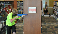 NWA Democrat-Gazette/MICHAEL WOODS &bull; @NWAMICHAELW<br /> Dylan Osborne, 11, from Fayetteville takes aim at a red team member during a laser tag game Friday, August 7, 2015, at the Fayetteville Public Library.  The after hours later tag games were part of the Teen Summer Reading Finale Party that included a variety of games, prizes and snacks for kids who completed grades 6 through 12.