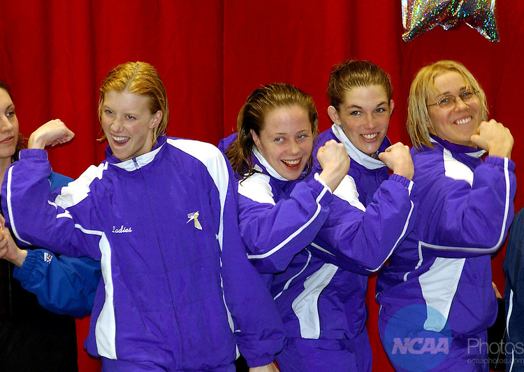 16 MARCH 2002: Beth Galloway, Erinn Hurley, Emelyne Dengler and Agnese Ozolina of the Kenyon 400 yard relay team flex their muscles after winning the realy with a time of 3:26.85, during the Division III Women's Swimming and Diving Championships held at the College of Wooster at Oxford, in Ohio. Nick Falzerano/NCAA Photos