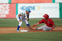 Dariel Gomez (25) of the Johnson City Cardinals avoids the tag from Jose Marquez (4) of the Burlington Royals as he steals second base at Burlington Athletic Stadium on July 15, 2018 in Burlington, North Carolina. The Cardinals defeated the Royals 7-6.  (Brian Westerholt/Four Seam Images)