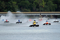 Steven Dawe, (#22) leads the field down the front straight for the first time. (SST-45 class)
