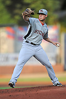 Hickory Crawdads starting pitcher Andrew Faulkner #23 delivers a pitch during a game against the Asheville Tourists at McCormick Field on August 22, 2013 in Asheville, North Carolina. The Tourists won the game 7-4. (Tony Farlow/Four Seam Images)