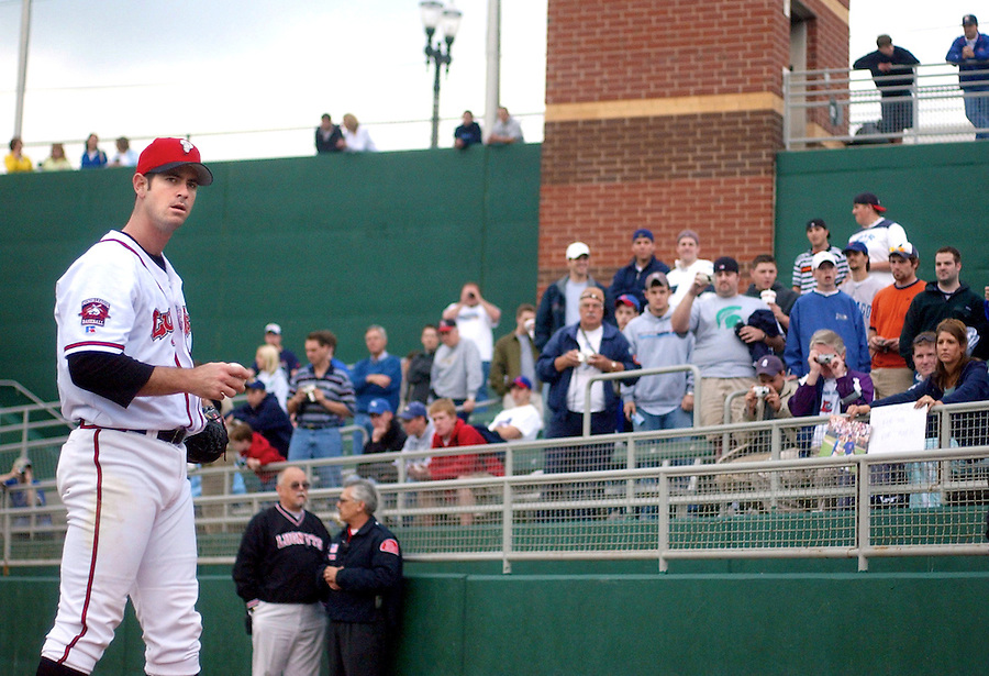 Chicago Cubs pitcher Mark Prior looks around while warming up for his Single-A rehab start with the Cubs affiliate, Lansing Lugnuts in the 2004 season.