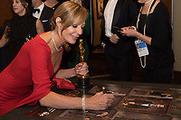 Allison Janney signs a poster backstage after winning the Oscar&reg; for performance by an actress in a supporting role for work on &ldquo;I, Tonya&rdquo; during the live ABC Telecast of The 90th Oscars&reg; at the Dolby&reg; Theatre in Hollywood, CA on Sunday, March 4, 2018.<br /> *Editorial Use Only*<br /> CAP/PLF/AMPAS<br /> Supplied by Capital Pictures