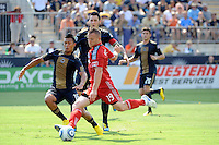 Chad Barrett (19) of Toronto FC takes a shot as Michael Orozco Fiscal (16) of the Philadelphia Union defends. The Philadelphia Union defeated Toronto FC 2-1 on a second half stoppage time goal during a Major League Soccer (MLS) match at PPL Park in Chester, PA, on July 17, 2010.