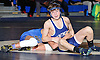 Ryan Mock of Huntington, right, battles Tony Negron of North Babylon at 106 pounds in the opening round of the Suffolk County varsity wrestling championship at North Babylon High School on Wednesday, Jan. 27, 2016. Mock won by decision 5-4 to help 13th seeded Huntington to a 34-33 upset over fourth seeded North Babylon.