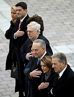 Congressional leaders from left to right, Speaker of the House Paul Ryan, R-Wis, Senate Majority Leader Mitch McConnell, R-Ky., Senate Minority Leader Chuck Schumer, D-NY, and House Minority Leader Nancy Pelosi, D-Calif., watch as a U.S. military honor guard carries the flag-draped casket of former U.S. President George H. W. Bush from the U.S. Capitol Wednesday, Dec. 5, 2018, in Washington. <br /> Credit: Win McNamee / Pool via CNP / MediaPunch