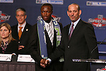 15 January 2009: Steve Zakuani (left), with MLS Commissioner Don Garber, was taken with the first overall pick by Seattle Sounders FC. The 2009 Major League Soccer SuperDraft was held at the Convention Center in St. Louis, Missouri in conjuction with the National Soccer Coaches Association of America's annual convention.