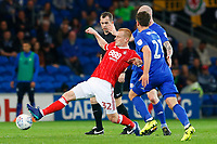 Ben Watson of Nottingham Forest is challenged by Craig Bryson and Aron Gunnarsson of Cardiff City during the Sky Bet Championship match between Cardiff City and Nottingham Forest at the Cardiff City Stadium, Wales, UK. Saturday 21 April 2018