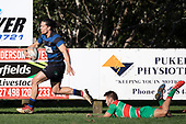 Jackson Orr steps out of Aaron Yuill's attempted tackle as he races down field. Counties Manukau Premier Club Rugby game between Onewhero and Waiuku, played at Onewhero on Saturday May 26th 2018. Onewhero won the game 24 - 20 after leading 17 - 12 at halftime. <br /> Onewhero Silver Fern Marquees 24 -Vaughan Holdt, Filipe Pau, Sean Bagshaw tries, Rhain Strang 3 conversions, Rhain Strang penalty.<br /> Waiuku Brian James Contracting 20 - Christian Walker, Fuifatu Asomua, Aaron Yuill tries, Christian Walker conversion, Christian Walker penalty .<br /> Photo by Richard Spranger.