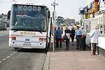 Great Yarmouth seaside resort, Norfolk, England Coach parked outside hotel with elderly passengers boarding for a day trip, Great Yarmouth seaside resort, Norfolk, England
