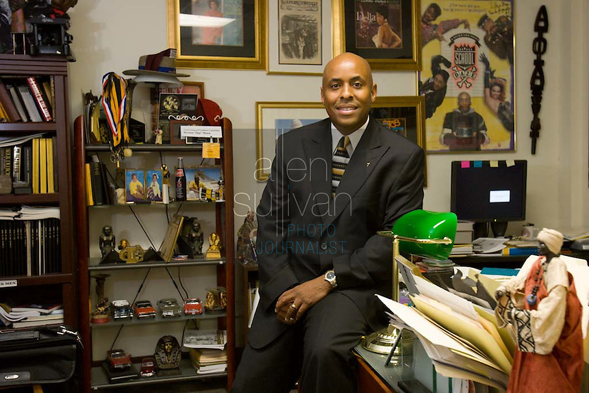 "Herman ""Skip"" Mason poses in his office at Morehouse College. Decades of research helped Mason organize a reunion recently of people descended from Mason's slave ancestors and from the owners of those slaves."