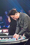 Young Cho shows his displeasure after losing a hand to Kido Pham, who reacts to doubling up.