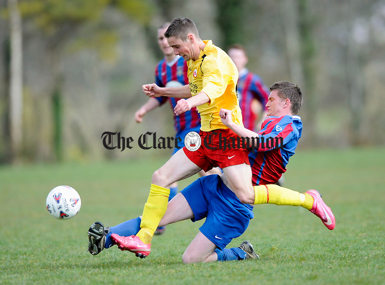 Avenue's David Smyth is tackled by Shannon Olympic's Ian Hogan during their junior cup game at Lees Road. Photograph by John Kelly.