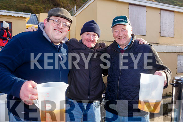 Seamus Lane, Billy Mangan and Mike Barry helping the swimmers warm up after the Fourth Annual Connie Harnett Memorial Swim in Ballybunion on New Years Day.