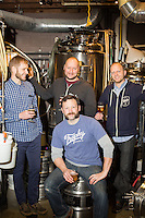 """Back left to right to front: Co-founders David Meeker,  David """"Woody"""" Lockwood, Chris Powers and head brewer Les Stewart of Trophy Brewing in Raleigh, N.C. on Saturday, March 14, 2015. (Justin Cook)"""