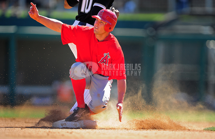 Mar. 14, 2012; Phoenix, AZ, USA; Anaheim Angels outfielder (25) Peter Bourjos is tagged out at second base in the fifth inning against the Chicago White Sox at The Ballpark at Camelback Ranch. Mandatory Credit: Mark J. Rebilas-
