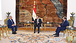 This handout picture released by the Egyptian Presidency on April 14, 2019, shows Egyptian president Abdel Fattah al-Sisi (C) and intelligence chief Abbas Kamel (R) meeting Libyan strongman Khalifa Haftar (L) at the Ittihadia presidential Palace in the capital Cairo.  Egyptian President Abdel Fattah al-Sisi met Sunday with Libyan commander Khalifa Haftar whose forces are fighting for control of the capital Tripoli, state media reported. Sisi has been an ardent supporter of Haftar's forces, which control swathes of eastern Libya and launched an offensive on April 4 to take the capital. Photo by Egyptian President Office