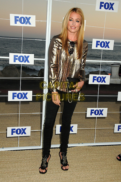 Cat Deeley.Fox All Star Party 2011 held at Gladstones Malibu, Pacific Palisades, California, USA, 5th August 2011..full length  trousers bag open toe shoes gold  shiny lame top long sleeve  black  .CAP/ADM/BP.©Byron Purvis/AdMedia/Capital Pictures.