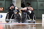 QLD's Cameron Carr looks determined as he works to pass Victoria's Jayden Warn in the final of the National Wheelchair Rugby Championships 2013 <br />