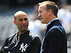 New York Yankees shortstop No. 2 Derek Jeter, left, chats with Denver Broncos quarterback Peyton Manning during batting practice taken before the start of a Major League Baseball game versus the Tampa Bay Rays at Yankee Stadium on May 4, 2014.<br /> <br /> James Escher